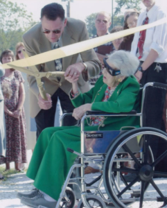 Ms. Bessie Ward cutting the ribbon for ground breaking at Fletcher First Baptist Church